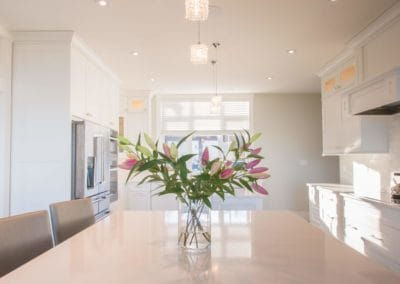 Flowers on one of two islands in kitchen of home