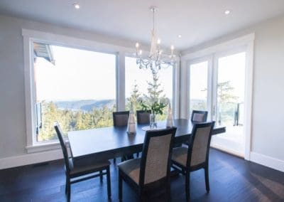 Dining area with large windows and view of Cowichan Valley