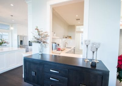 White cabinetry and beautiful kitchen in custom built home