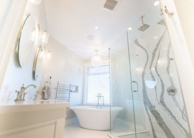 Full view of bright white custom bathroom with standing tub, shower with rain head goldstream heights custom home