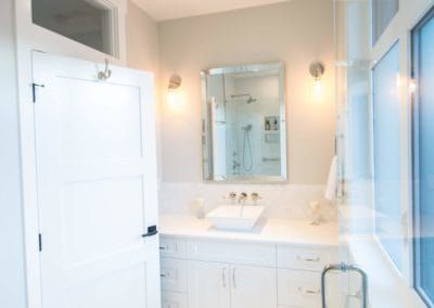 Bright white bathroom with glass, chrome fixtures