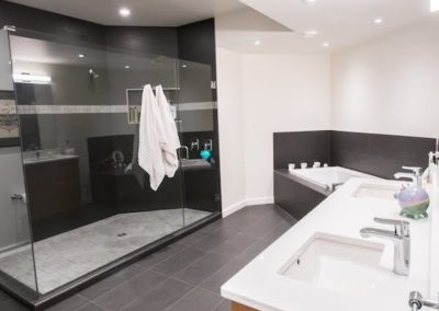 Large-bathroom-with-custom-shower-in-Bare-Point-home