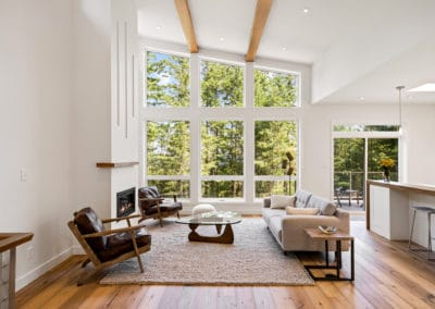 Vaulted ceilings and many windows in custom home living room