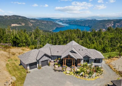 Goldstream heights Custom home exterior with rock and exposed timber, located in Cowichan Valley