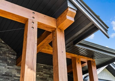 close up detailing of timber framing front entry exterior goldstream heights custom home