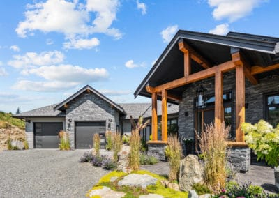 Exterior of goldstream heights custom home build in Cowichan Valley with garage