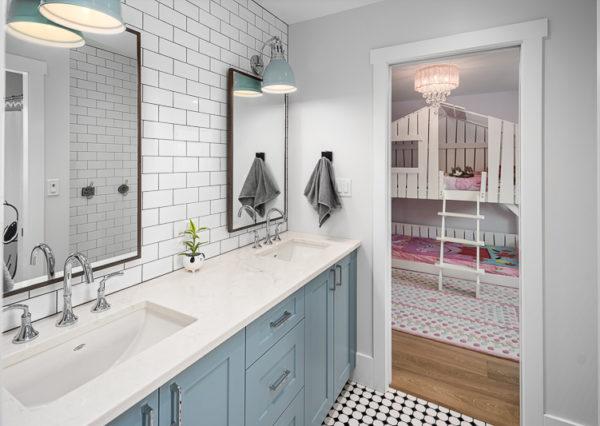 Jack and Jill bathroom with blue vanity