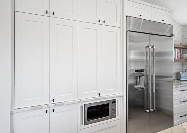 Custom white shaker cabinetry with black hardware